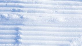 Rayures parallèles dans la neige Images stock