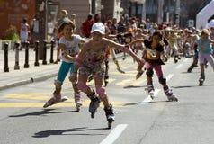 Raza de Rollerskates Foto de archivo libre de regalías