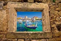 Razanac turquoise waterfront through stone window Stock Images
