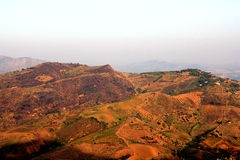 Razed hills. A picture of a hill, red after being razed by fires Stock Photography