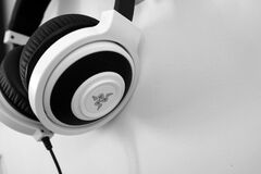 Razer White and Black Corded Headphones royalty free stock photos