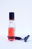 Razor and aftershave lotion Royalty Free Stock Photo