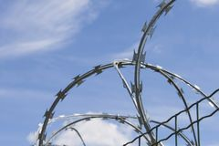 Razor Barbed wire against a blue sky Stock Photo