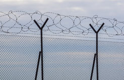 Razor Barbed wire against a blue sky, closeup Stock Image