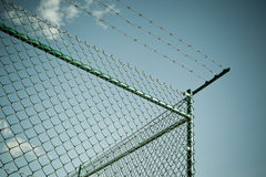 Razor and barbed wire fence Stock Photo