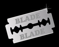 Razor blade. On a black background Stock Images