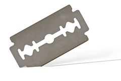 Razor Blade. Isolated over a white background Royalty Free Stock Photos