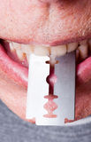 Razor Blade in Teeth Royalty Free Stock Images