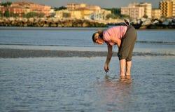 Razor clam digger in Italy Stock Photos