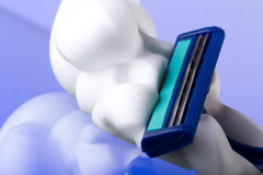 Razor and foam Stock Images