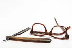 Razor and glasses Stock Photography