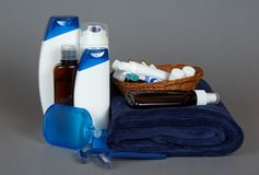 Razor, lotion, cosmetics set in basket and towel Royalty Free Stock Images