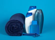 The razor, lotion, shampoo and towel Royalty Free Stock Image
