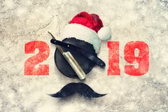 Razor on a plate for foam with a Santa Claus hat on a gray background. Inscription 2019. Greeting card Happy New Year stock illustration