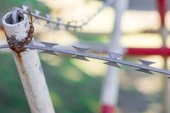 Razor ribbons on metal poles Royalty Free Stock Photos
