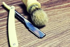 Razor sharp soap brush. Razor sharp and soap brush retro style on wooden table Stock Photos