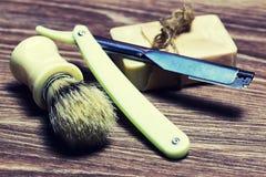 Razor sharp soap brush. Razor sharp and soap brush retro style on wooden table Stock Photography