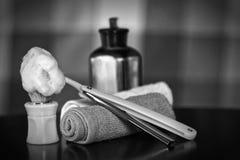 Razor shaving accessories razor. Mens cosmetics shaving brush and straight razor in a wooden basket royalty free stock photography