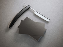 Razor with stack of business cards. Razor with stack of black business cards Royalty Free Stock Image