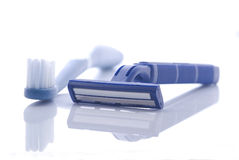 Razor and toothbrush on white Stock Photos