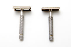 Razor. Two ancient razors on white background Stock Photos