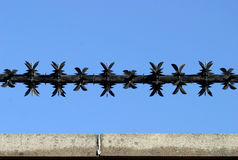 Razor Wire 2. Razor wire section above wall royalty free stock photography