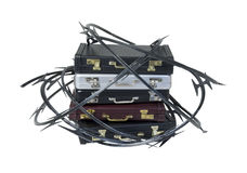 Razor Wire Around a Stack of Briefcases Stock Images