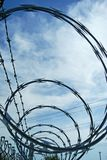 Razor wire and barbed wire fencing Stock Photo
