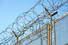 Razor wire barbed wire top of security fence Royalty Free Stock Images