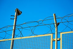 Razor wire barbed wire top of security fence Royalty Free Stock Photography