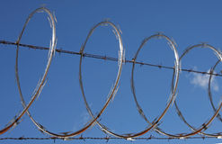 Razor wire. Close up of razor wire fence Royalty Free Stock Images