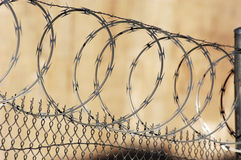 Razor wire fence. Chain link fence with razor wire Royalty Free Stock Photography