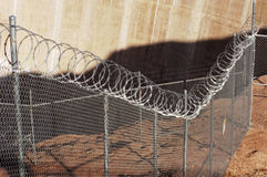 Razor wire fence. Chain link fence with razor wire Royalty Free Stock Image