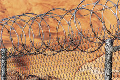 Razor wire fence. Chain link fence with razor wire Stock Images