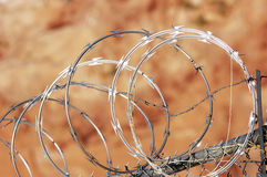 Razor wire fence. Chain link fence with razor wire Royalty Free Stock Photo