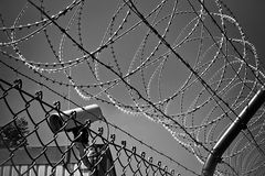 Razor wire fence and CCTV camera stock photo