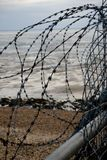 Razor wire fence. On the edge of an army firing range Royalty Free Stock Photos
