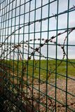Razor wire fence. On the edge of an army firing range Royalty Free Stock Image