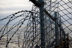 Razor wire fence. On the edge of an army firing range Stock Images