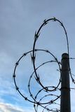 Razor wire fence silhouette Stock Photos