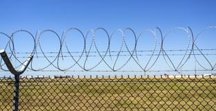 Razor Wire with Love. Consecutive heart shapes created by the razor wire at the airport fencing in Brisbane, Australia Stock Image