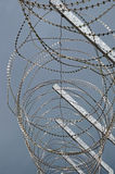 Razor wire on prison fence. Detail of a prison fence with razor wire Royalty Free Stock Images