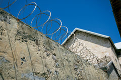Razor wire prison wall. Razor wire attached to the top of a concrete wall in Fremantle Prison in Australia stock photos