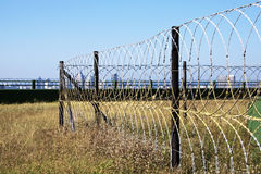 Razor Wire Security Fence Surrounding Protected Structure Royalty Free Stock Photos