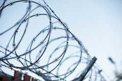 Razor wire silhouette Stock Photos