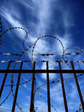 Razorwire. A gate with Razorwire for security concepts Stock Photos