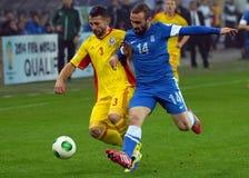 Razvan Rat och Dimitros Salpigidis i FIFA världscupslutspel Royaltyfri Fotografi