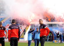 Razvan Stanca reacts while Steaua Bucharest footbal fans cheer w Stock Photo