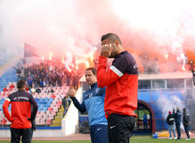 Razvan Stanca reacts while Steaua Bucharest footbal fans cheer w Royalty Free Stock Photography