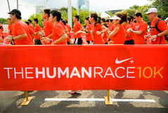 Razza umana di Nike+ (Singapore) Immagine Stock